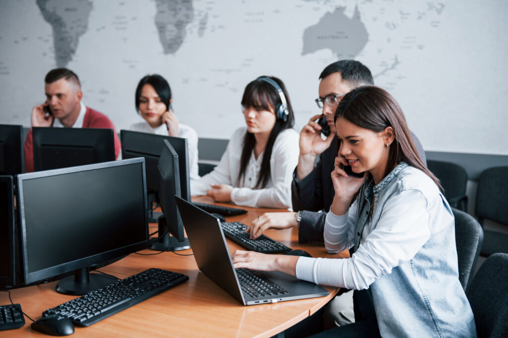 everyone-doing-his-job-young-people-working-call-center-new-deals-is-coming